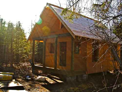 Simple affordable build it yourself approach to a cabin for Building a small cabin in the woods