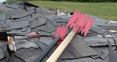shingle_rippers-on-pile-of-old-shingles-after-removal-featured