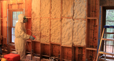 installation of spray foam insulation between wall joists